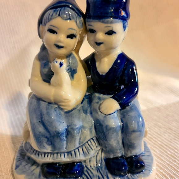 Vintage Delft Couple Sitting on A Bench